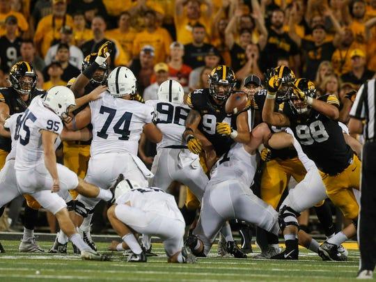 Members of the Iowa line block Penn State kicker Tyler Davis' field goal attempt on Saturday, Sept. 23, 2017, at Kinnick Stadium in Iowa City.