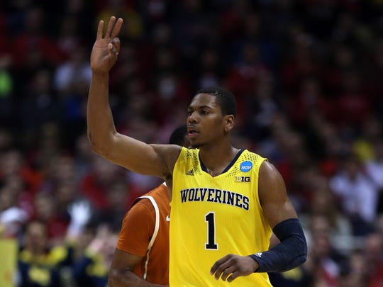 MILWAUKEE, WI - MARCH 22:  Glenn Robinson III #1 of the Michigan Wolverines celebrates a three point shot in the second half against the Texas Longhorns during the third round of the 2014 NCAA Men's Basketball Tournament at BMO Harris Bradley Center on March 22, 2014 in Milwaukee, Wisconsin.  (Photo by Jonathan Daniel/Getty Images)