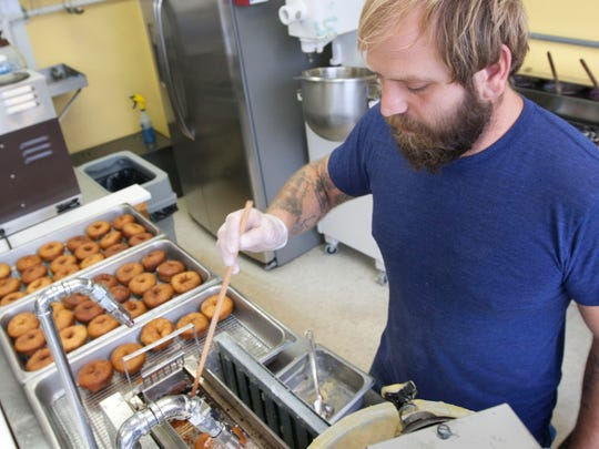Dominic Livolsi, owner of Uncle Dood's Donuts in Toms River, fries doughnuts at his shop.