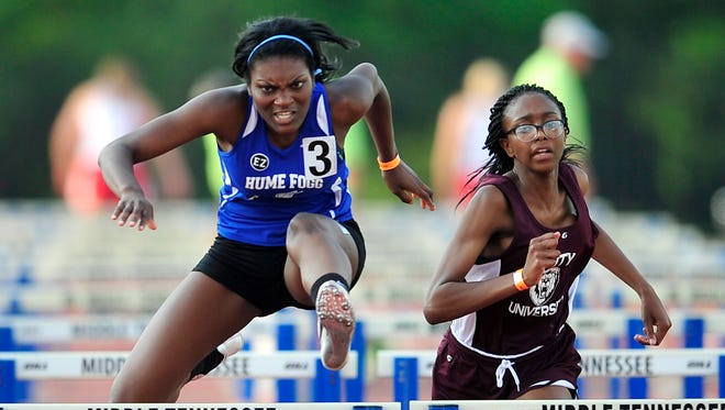 Hume-Fogg's Cyra Beard (3) competes in the Class A/AA 100 meter hurdles at the TSSAA Track & Field State Championships at MTSU in Murfreesboro, Tenn., Thursday, May 20, 2014.