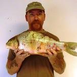 Strafford bowfisherman David Weaver shot this 7 pound, 10 ounce quillback at Lake Taneycomo.