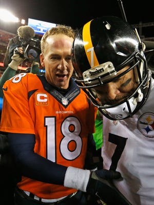 Broncos QB Peyton Manning has a word with  Steelers QB Ben Roethlisberger after the AFC Divisional Playoff Game at Sports Authority Field at Mile High on Sunday.