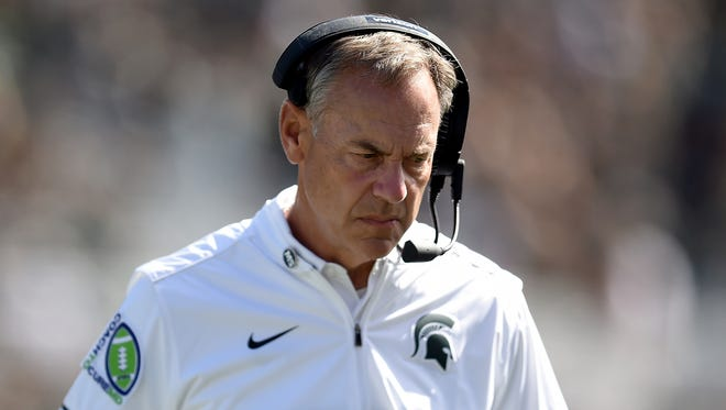 Mark Dantonio, head coach of the Michigan State Spartans, reacts on the sidelines during the game against the Wisconsin Badgers at Spartan Stadium on September 24, 2016 in East Lansing.