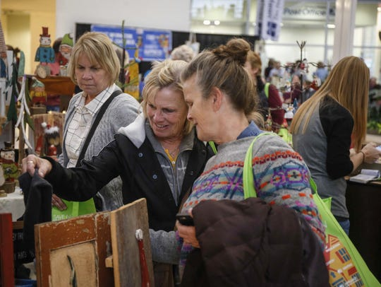 Shoppers search for gift items at the Downtown Winter