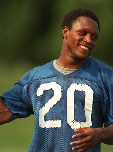Detroit Lions' running back Barry Sanders plays around with a ball during a break in afternoon practice at The Silverdome practice facility on Aug. 15, 1995.