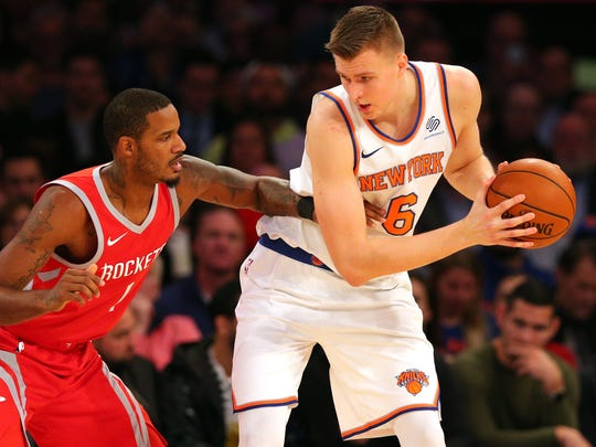 Kristaps Porzingis controls the ball against Houston Rockets small forward Trevor Ariza during the second quarter at Madison Square Garden.