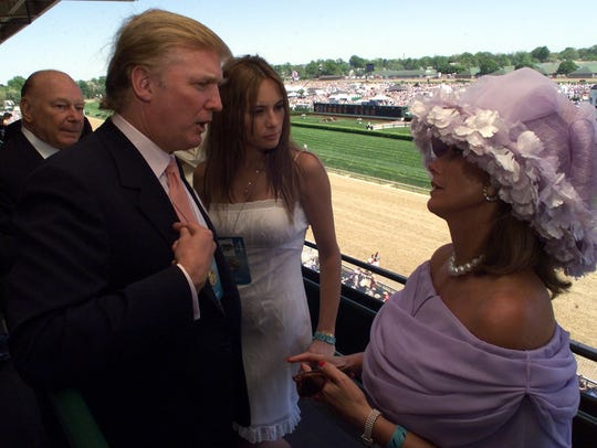 "Donald Trump and then girlfriend, Melania, talks with K One King owner Madeline Paulson, right in the Skye Terrace in 1999. When asked if he were here to buy Churchill Downs he said, ""I'd like to."""