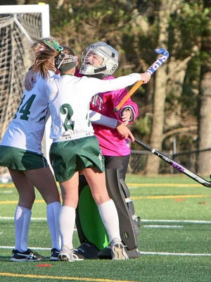 Oakmont Regional goaltender Sam Gastonguay, right, celebrates a 3-0 District quarterfinal victory over Narragansett with teammates Gianna Moorshead (14) and Kaitlyn Shea (2) last fall. In addition to field hockey, Gastonguay played basketball and was a four-year member of Oakmont's Unified Track team.