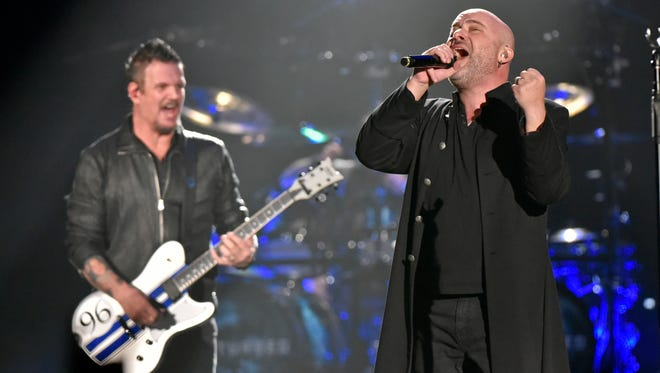 David Draiman, right, and Dan Donegan of the band Disturbed perform at the Allstate Arena in Rosemont, Ill.