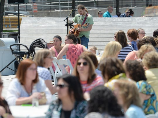 Full tables and sunshine were the rule at this year's first Dine on the Deck lunchtime event on the CityDeck in Green Bay. Diners enjoy the weather as Jeff Hinnendael plays guitar and sings for the crowds.
