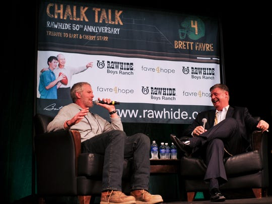 Brett Favre recounts with moderator Bill Michaels, right, anecdotes from his playing days at the 3rd annual Chalk Talk to benefit Rawhide Boys Ranch at KI Convention Center in downtown Green Bay.