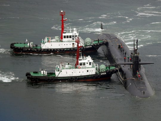 The nuclear-powered submarine USS Michigan approaches to join the U.S. aircraft carrier USS Carl Vinson in drills near the Korean Peninsula, at Busan port in Busan, South Korea, Tuesday, April 25, 2017. North Korea marks the founding anniversary of its military on Tuesday, and South Korea and its allies are bracing for the possibility that it could conduct another nuclear test or launch an intercontinental ballistic missile for the first time. (Jo Jung-ho/Yonhap via AP)
