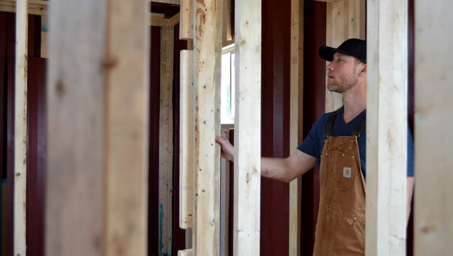Patrick Staggs inspects progress on Homes of Hope's prototype on March 23, 2016. Homes of Hope converts old storage containers into self-sustained two bedroom homes.