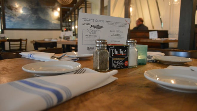 Phillips Seafood House's tables now feature cloth napkins and a new catch of the day menu.