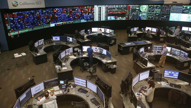 Staffers at the California Independent System Operator's control center, just outside Sacramento, keep the state's electric grid running smoothly on Dec. 16, 2016.