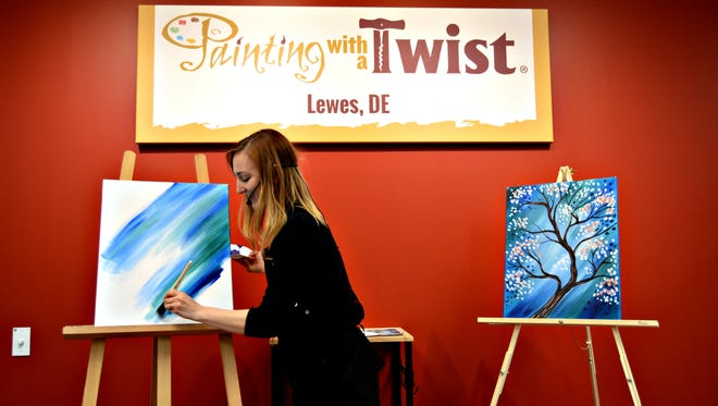 Katie Champagne led the inaugural class at Painting with a Twist in Lewes in 2016 in this file photo. The studio will host a fundraiser to benefit the Alana Rose Foundation Feb. 23.