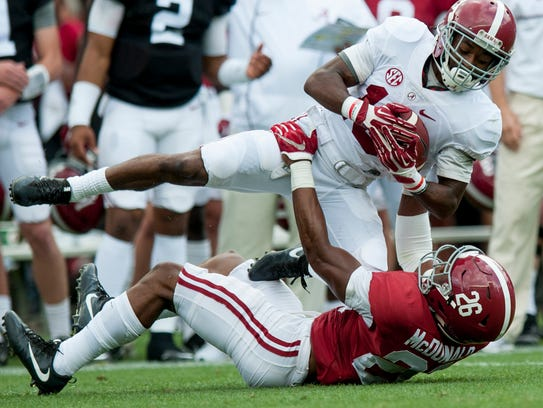 Alabama wide receiver Xavian Marks (19) is stopped