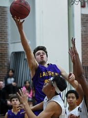 Lassen's Wyatt Martin goes up to score against Sparks during Tuesday's game at Sparks.