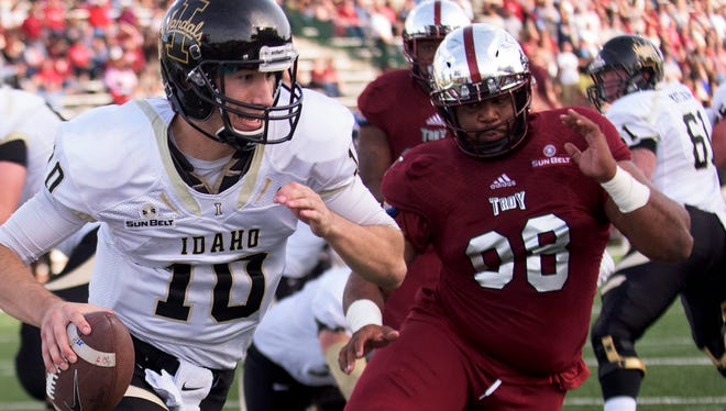 Troy's Lonnie Gosha (98) chases Idaho quarterback Matt Linehan (10) throughout the end zone at Veterans Memorial Stadium in Troy, Ala. on Saturday October 17, 2015. Linehan got a pass away on the play. (Mickey Welsh / Montgomery Advertiser)