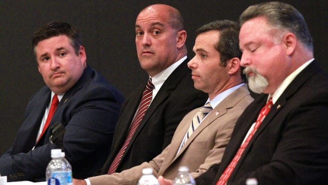 Candidates for Lafayette Parish Sheriff John P. Rogers, from left, Chad Leger, Mark Garber and Rick Chargois participate in a Lafayette Parish sheriff candidates forum hosted by the Upper Lafayette Economic Development Foundation Thursday, May 21, 2015, at the LITE Center in Lafayette, La.