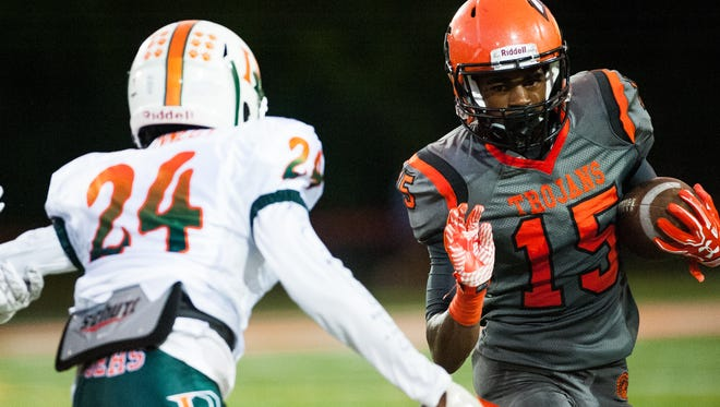 Lely High School's Taejon Wright (15) takes the ball downfield during a game against Dunbar High School in Naples on Friday, Sept. 16, 2016.