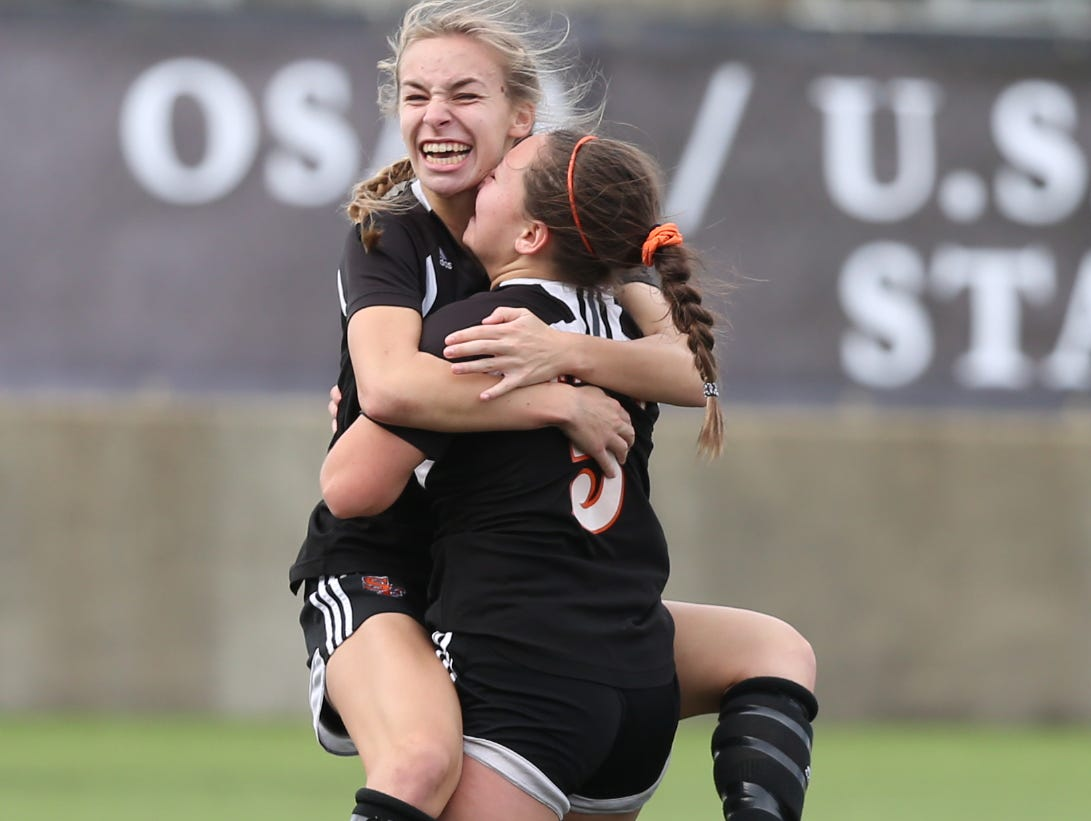 Silverton's Isabelle Haselip embraces Paige Alexander after she scored a goal to tie the game with La Salle during the OSAA Class 5A State Championship game on Saturday, Nov. 12, 2016, at Hillsboro Stadium. La Salle defeated Silverton 3-2 in overtime.
