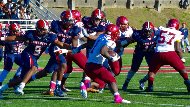 Robinson DeLaCruz (9) and Malcolm Koonce (1) pursue  Justin Covington during Stepinac's 43-21 win Saturday.