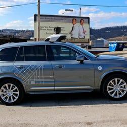 Uber halts self-driving car tests after Arizona crash