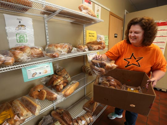 Volunteer Mary Houston of Urbandale stocks the food pantry at Catholic Charities St. Mary Family Center during the United Way of Central Iowa's Day of Action in 2014.