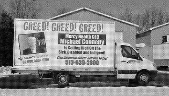 "A photograph of the mobile billboard is included in court documents filed by Mercy Health CEO Michael Connelly in his lawsuit against SEIU. The photo is listed as ""Exhibit A."""
