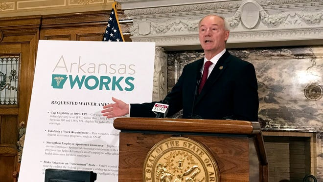 Arkansas Gov. Asa Hutchinson speaks during a news conference on Monday, March 6, 2017, in Little Rock, Ark.  Hutchinson said Monday that he wants to add a work requirement to Arkansas' hybrid Medicaid expansion and to lower its eligibility cap, which would add new restrictions to the program even as the future of the federal health overhaul remains unclear.