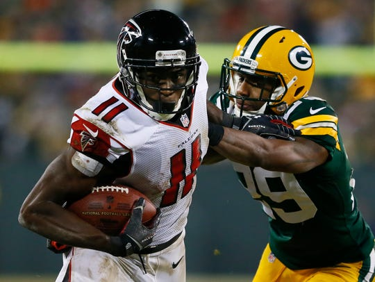 Falcons receiver Julio Jones looks to run after catching