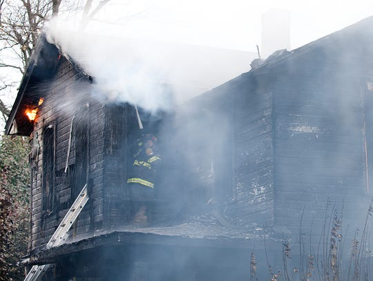Firefighters battle a fire that ignited inside 422-24