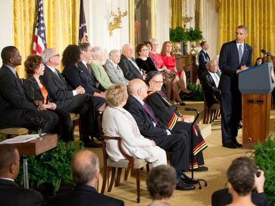 President Barack Obama, right, speaks before awarding