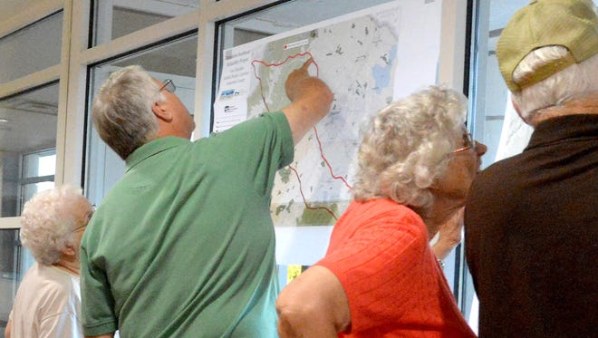 Concerned citizens check the maps of the planned route for Dominion's proposed natural gas pipeline. They gather at the Augusta County Government Center for an organizational meeting to prepare for their fight against the pipeline on Saturday, Sept. 6, 2014.