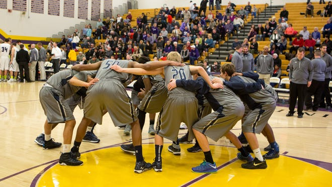 The Roosevelt boys basketball team gets prepared for a Feb. 11 game at Johnston.