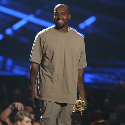 Kanye West accepts the video vanguard award at the