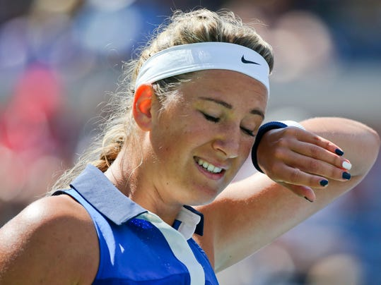 Victoria Azarenka, of Belarus, wipes sweat from her brow between points against Ekaterina Makarova, of Russia, during the quarterfinals of the 2014 U.S. Open tennis tournament, Wednesday, Sept. 3, 2014, in New York. (AP Photo/Mike Groll)
