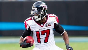Former Atlanta Falcons wide receiver and special teams specialist Devin Hester returns a punt in the second half against the Carolina Panthers at Bank of America Stadium.