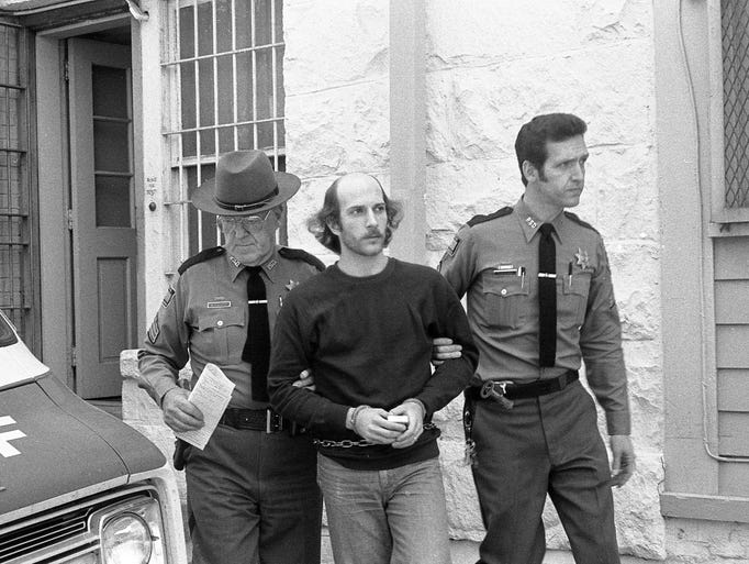 "Serge A. Motti was convicted of murdering two Putnam County, New York, women in order to steal their dog in what was known as the ""Kent kennel killings."" Here, he is taken away to prison on a sunny day in 1979."