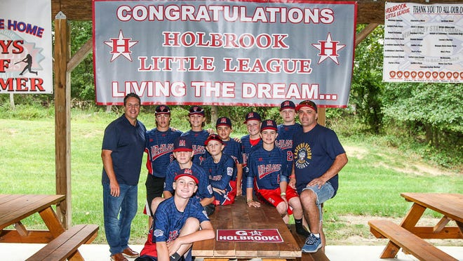 The Holbrook Little League team and coaches pose for a photo at a celebration party at the Knights of Columbus in Jackson, sponsored by the APP, Knights of Columbus and Mona Lisa's Pizza on September 2, 2017. (Photo by Keith Muccilli, Correspondent)
