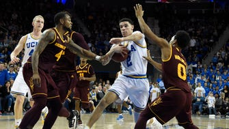 Jan 19, 2017: UCLA Bruins guard Lonzo Ball (2) drives to the basket between Arizona State Sun Devils guard Torian Graham (4) and guard Tra Holder (0) in the second half at Pauley Pavilion. UCLA won 102-80.