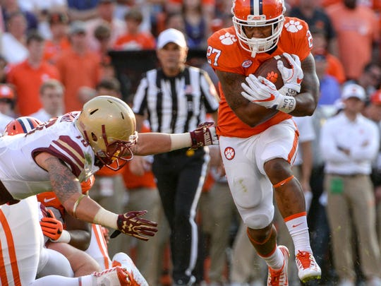 Clemson running back C.J. Fuller (27) runs by Boston College linebacker Ty Schwab (10) during the fourth quarter in Memorial Stadium at Clemson on Saturday.