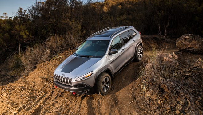 The 2014 Jeep Cherokee Trailhawk employs a 3.2-liter V6 attached to a nine-speed automatic transmission with manual shift mode.
