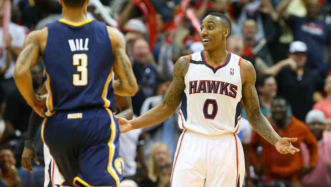 The Atlanta Hawks' Jeff Teague reacts to hitting a 3-pointer late in the fourth quarter against the Indiana Pacers in Game 3 of an Eastern Conference quarterfinal on Thursday, April 24, 2014, at Philips Arena in Atlanta. The Hawks won, 98-85, for a 2-1 series lead.