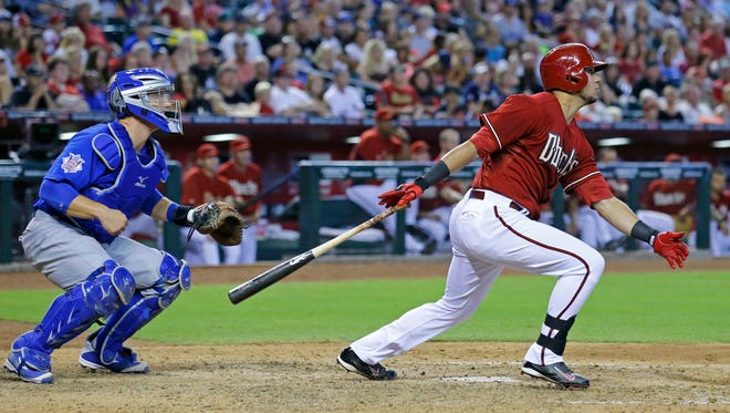 Arizona Diamondbacks left fielder David Peralta (6) hits a RBI single in the 7th inning against the Chicago Cubs in their MLB game Sunday, July 20, 2014 in Phoenix, Ariz.