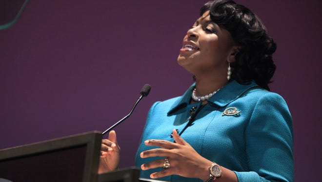 Mayor Lovely Warren addresses the crowd at the Auditorium Theatre during her public inaugural ceremony.