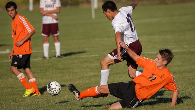 The Omro Foxes hosted Fond du Lac/Oakfield/Springs United in soccer Thursday, September 25, 2014.