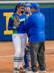 FGCU softball coach David Deiros meets with pitcher Riley Randolph against Florida State on March 14, 2017.