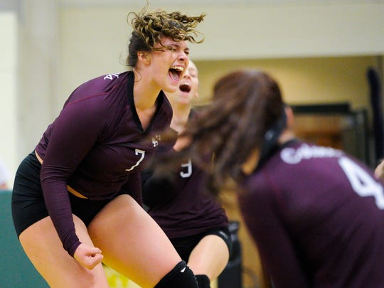 Henderson County's Libbie Dockemeyer (7) Kristin Logsdon (9) and Paige McElhaney (4) celebrate during their Second Region volleyball tournament game against Madisonville at University Heights Academy in Hopkinsville, Wednesday, Oct. 26, 2016. Henderson County beat Madisonville 3-0.
